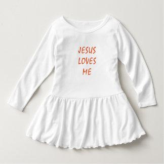 Jesus é vestido do plissado da criança do amor