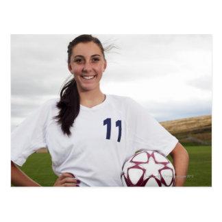 jogador de futebol adolescente de sorriso da cartão postal