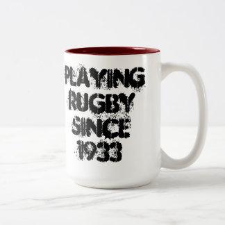 Jogando a caneca de café do rugby desde 1933