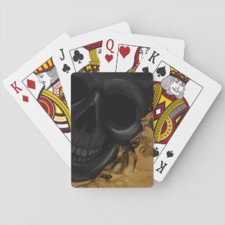 Jogo De Carta Crânio de sorriso preto cercado por bastões e por