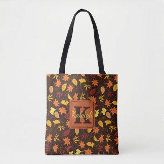 Laranja e bolsa do monograma das folhas da queda