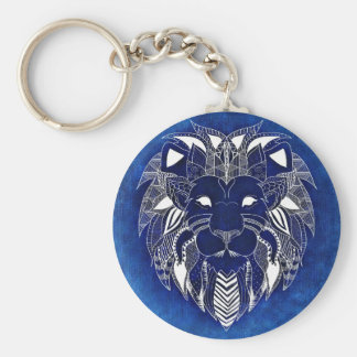 Leão branco com o chaveiro unisex do fundo azul