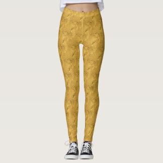 Legging Caneleiras metálicas do ouro