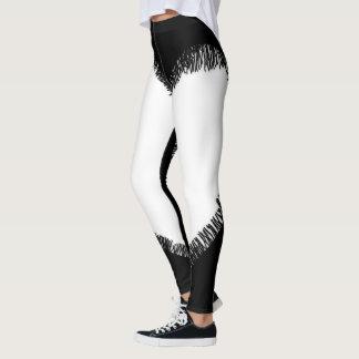 Legging Caneleiras rasgadas preto e branco de pano