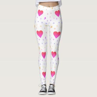 Legging Os corações modelam em caneleiras cor-de-rosa e