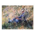 Leitura sob um Hawthorne de florescência Bush