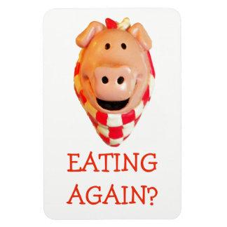 Lembrete engraçado da dieta do porco que come ímã