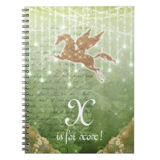 Letra X das luzes verdes do ouro do brilho do Caderno
