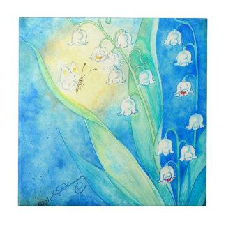 Lírios do vale com borboleta azulejos