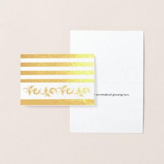 Listras do ouro e cartão de nota feito sob