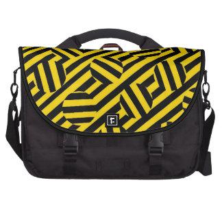 Listras e as bolsas amarelas dos círculos pastas para notebooks