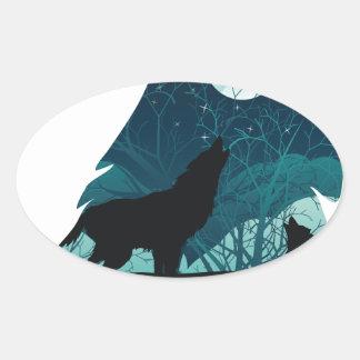 Lobo que urra com floresta adesivo oval
