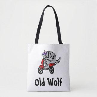 Lobo velho, lobo em um patinete bolsa tote