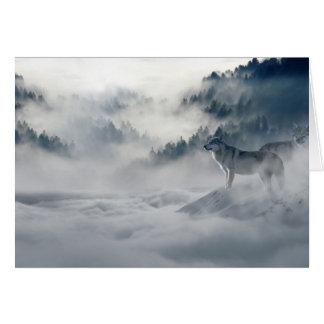 Lobos no cartão do inverno