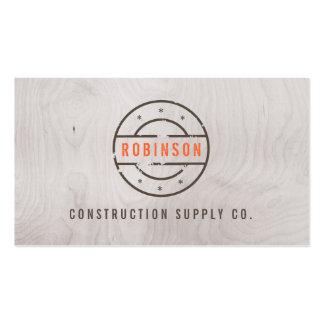 Logotipo carimbado rústico na construção cinzenta  modelo cartao de visita