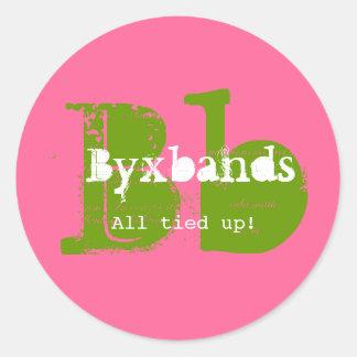 Logotipo verde e cor-de-rosa do negócio do adesivo