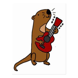 Lontra de mar engraçada que joga a guitarra cartão postal