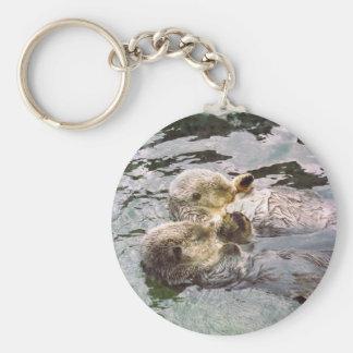 Lontras de mar que guardaram as mãos chaveiros