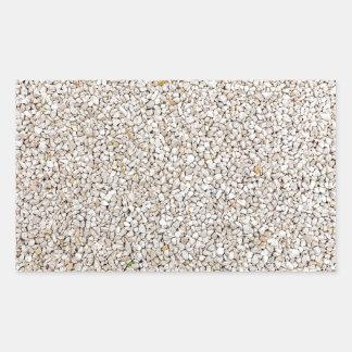 Lote de pedras cinzentas do cascalho como o fundo adesivo retangular