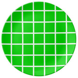 Louça Listras brancas corajosas da estrutura no verde do