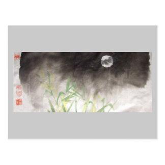 Lua sobre o cartão da grama