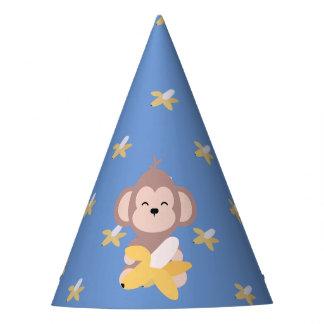 Macaco bonito de Kawaii com o chapéu do partido da