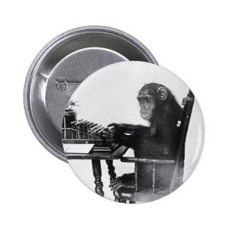Macaco de dactilografia botons