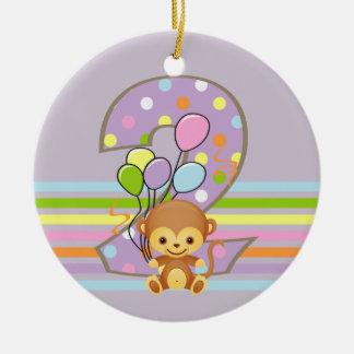Macaco do segundo aniversário e ornamento roxos