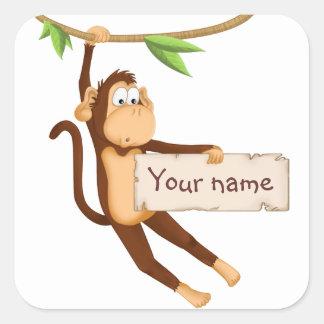 Macaco engraçado que guardara seu texto adesivo quadrado