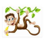 Macaco que balança com banana cartao postal