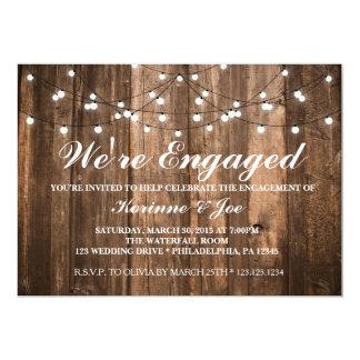 Madeira e luzes do convite do noivado