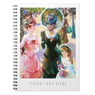 Mãe & filhas que pintam o caderno do presente das
