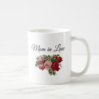 Mamã na caneca floral do buquê dos rosas da lei