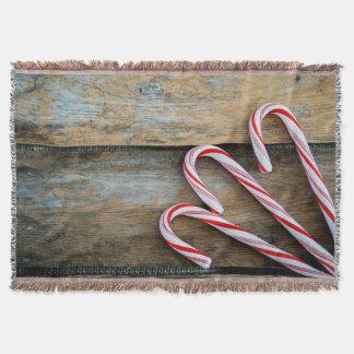 Manta Madeira rústica com os bastões de doces do Natal