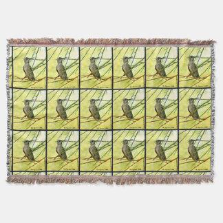 Manta Sonoran Hummer na cobertura amarela do lance