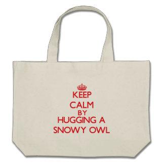 Mantenha a calma abraçando uma coruja nevado bolsas