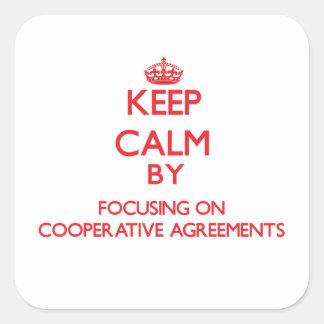 Mantenha a calma centrando-se sobre acordos adesivo em forma quadrada