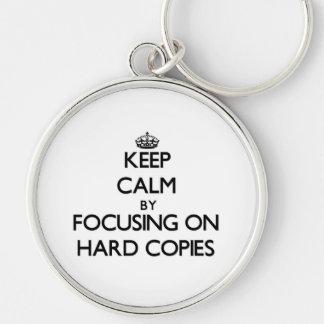 Mantenha a calma centrando-se sobre cópias chaveiro