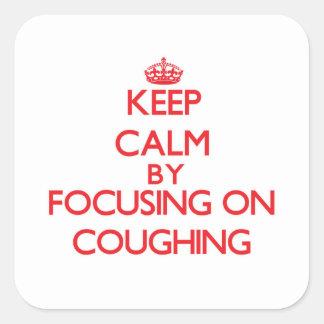 Mantenha a calma centrando-se sobre tossir adesivo em forma quadrada