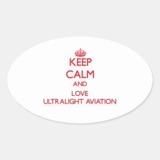 Mantenha a calma e ame a aviação ultraleve adesivos em formato ovais