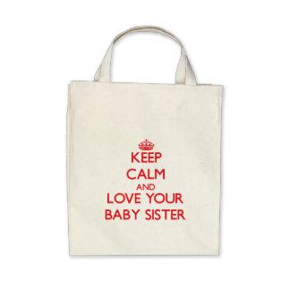 Mantenha a calma e ame sua irmã do bebê bolsas