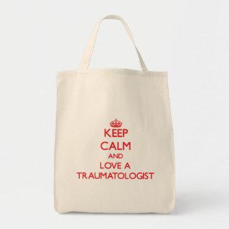 Mantenha a calma e ame um Traumatologist Sacola Tote De Mercado
