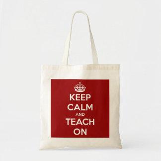 Mantenha a calma e ensine-a no bolsa vermelho do o