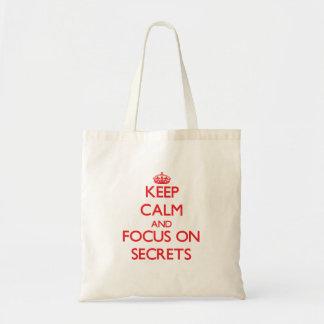 Mantenha a calma e o foco em segredos bolsas de lona