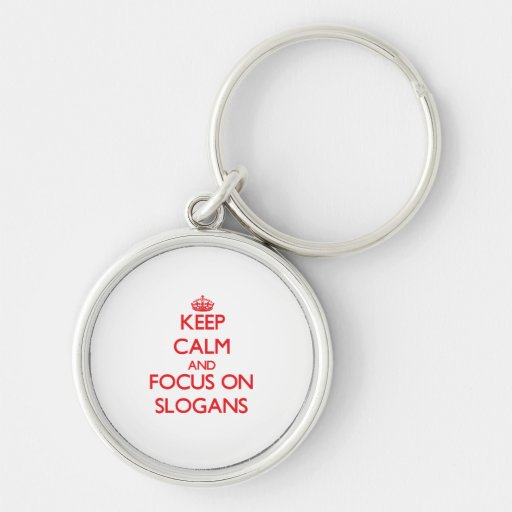 Mantenha a calma e o foco em slogan chaveiros