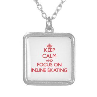 Mantenha a calma e o foco na patinagem do Em-Line Pingente