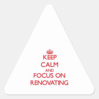 Mantenha a calma e o foco na renovação adesivo triangular
