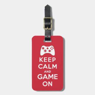 Mantenha a calma e o jogo sobre etiqueta de bagagem