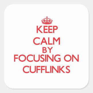 Mantenha a calma focalizando em botão de punho adesivo quadrado