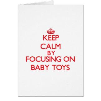Mantenha a calma focalizando em brinquedos do bebê cartoes